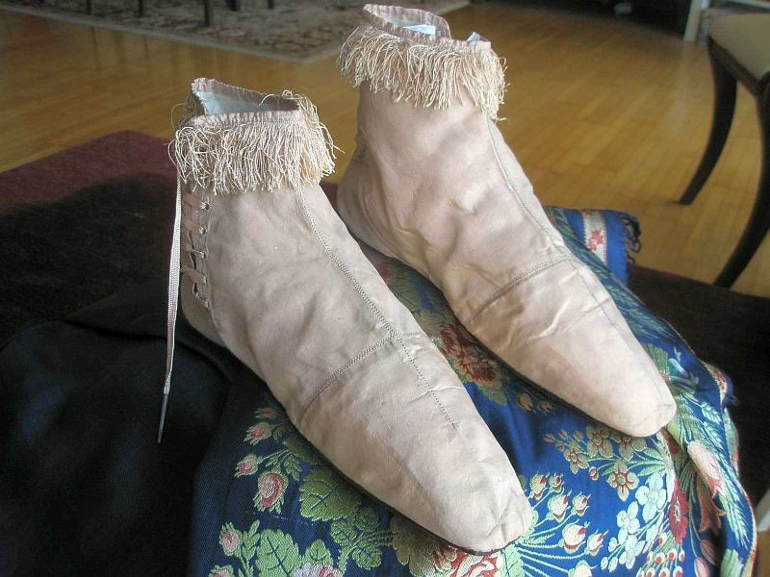 A pair of pink silk evening boots, French 1825 - 1830