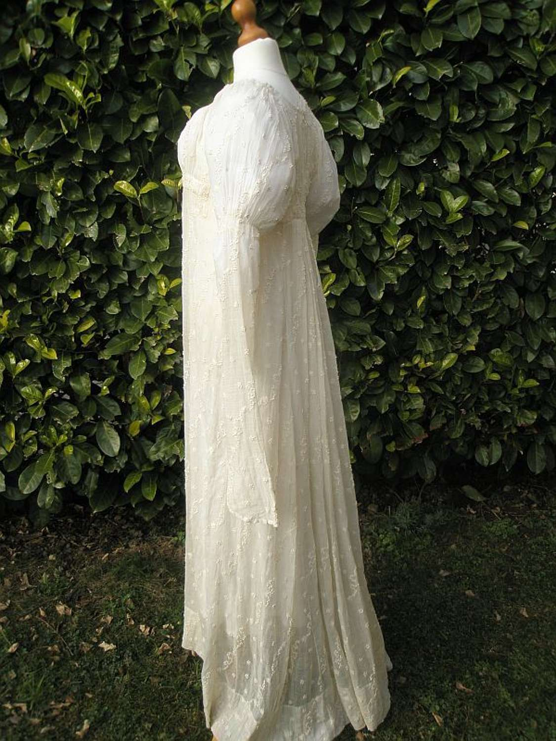 A pale cream embroidered muslin early 19th century gown ca.1805