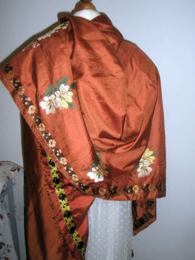 A coral silk floral woven square shawl. French ca. 1810