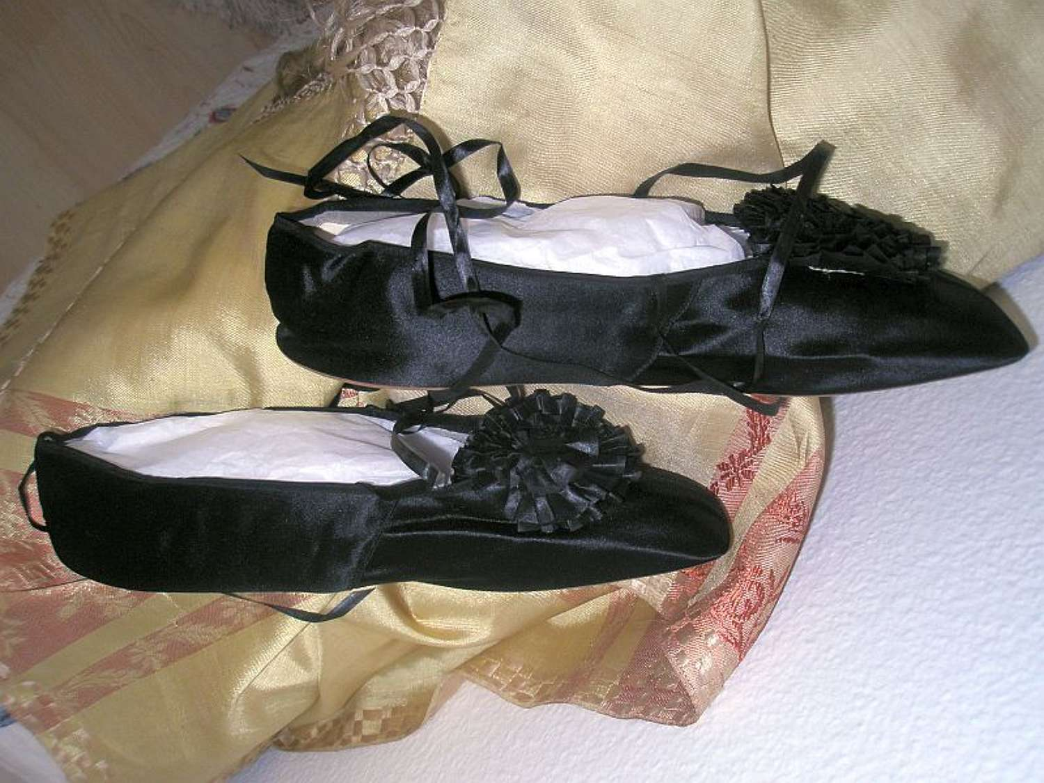 A pair of black silk dancing shoes. French  1830s