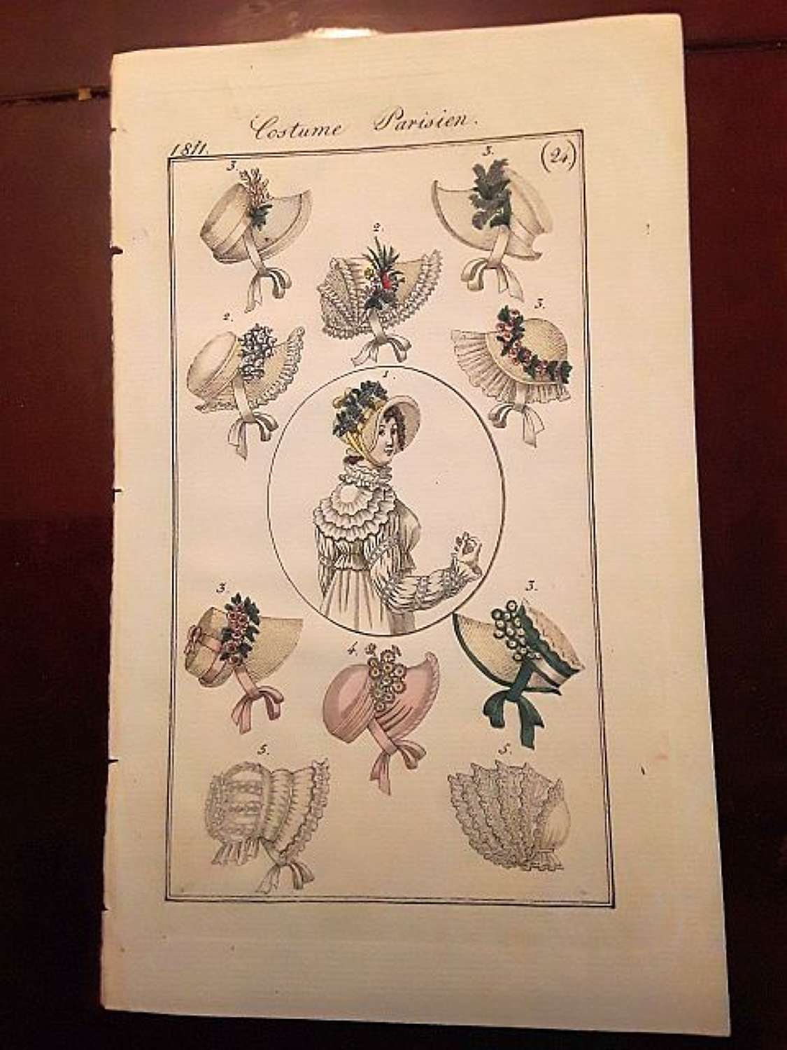 A charming antique fashion print of bonnets. French dated 1811