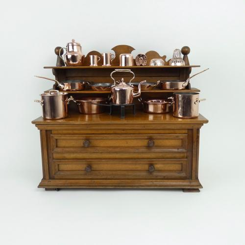 Miniature walnut dresser with copperware