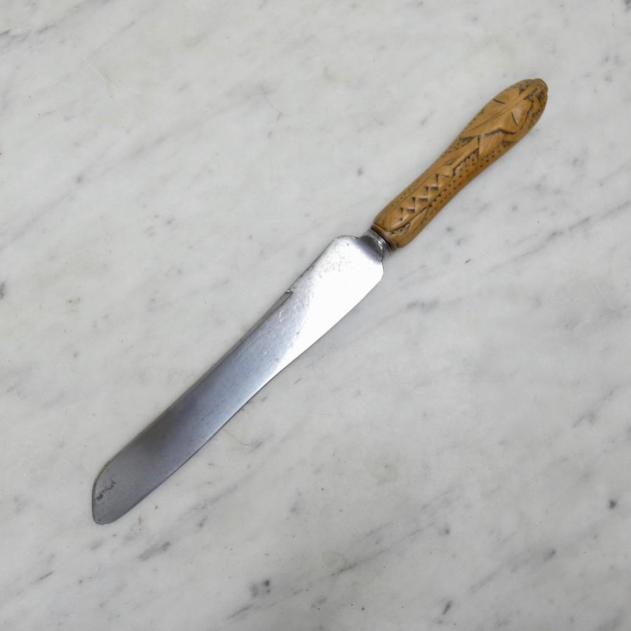 Victorian breadknife with ivy carving