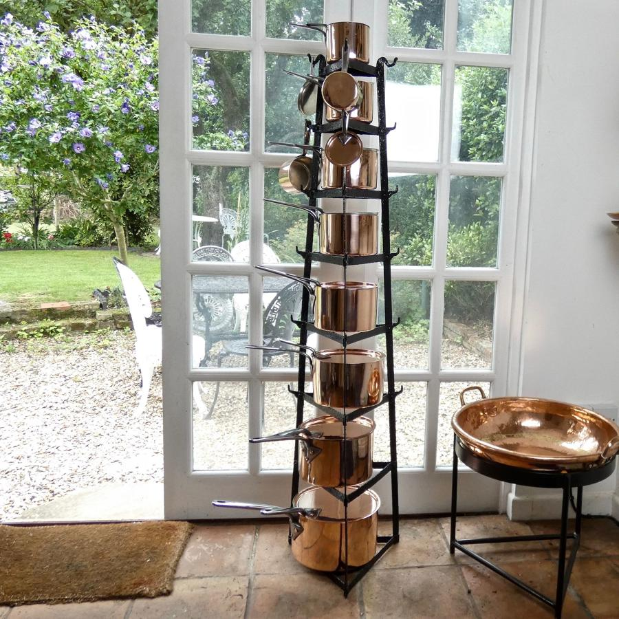 Set of usable, 19th century copper saucepans.
