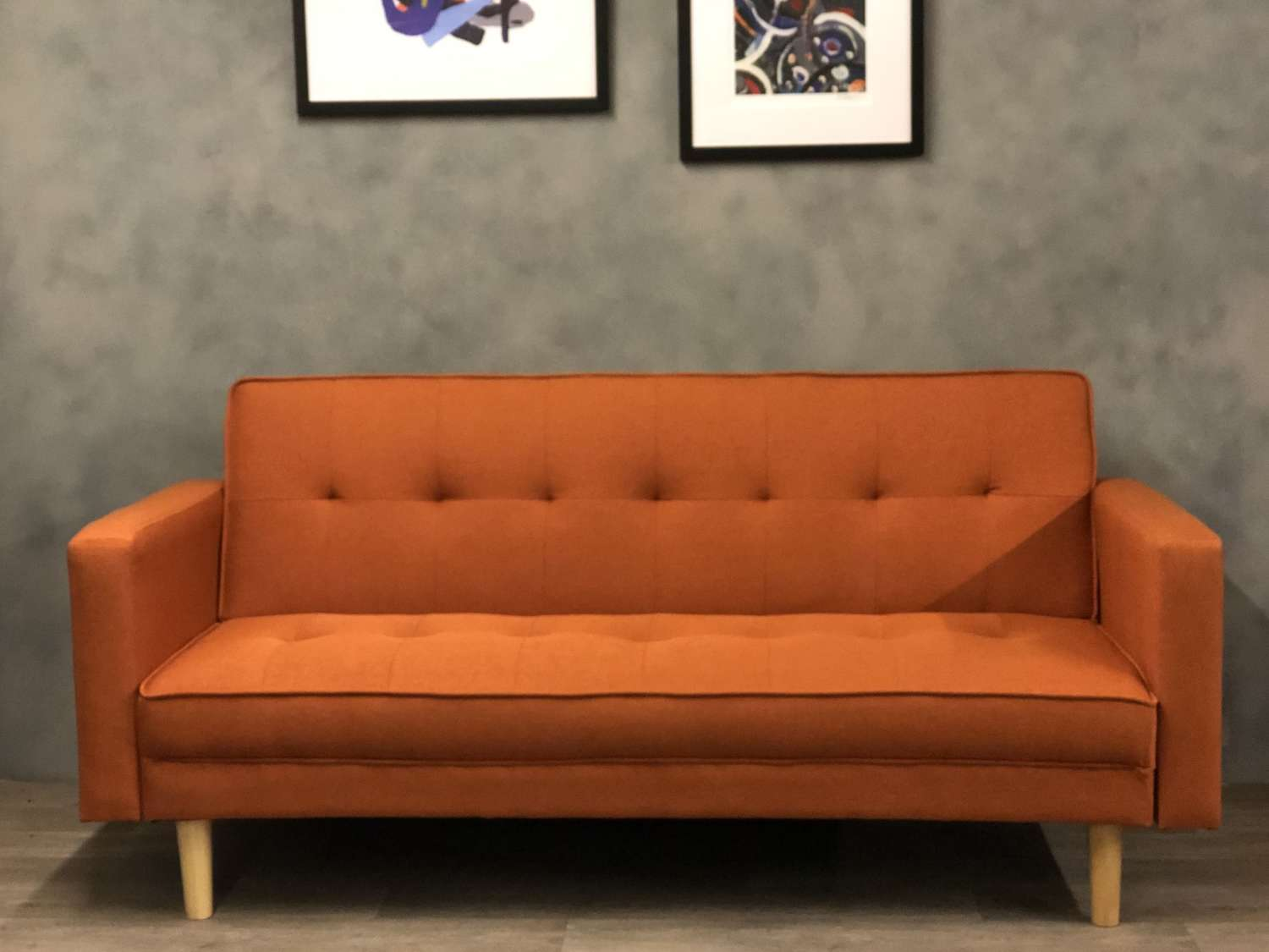 Orange midcentury style double sofa/ sofa bed.
