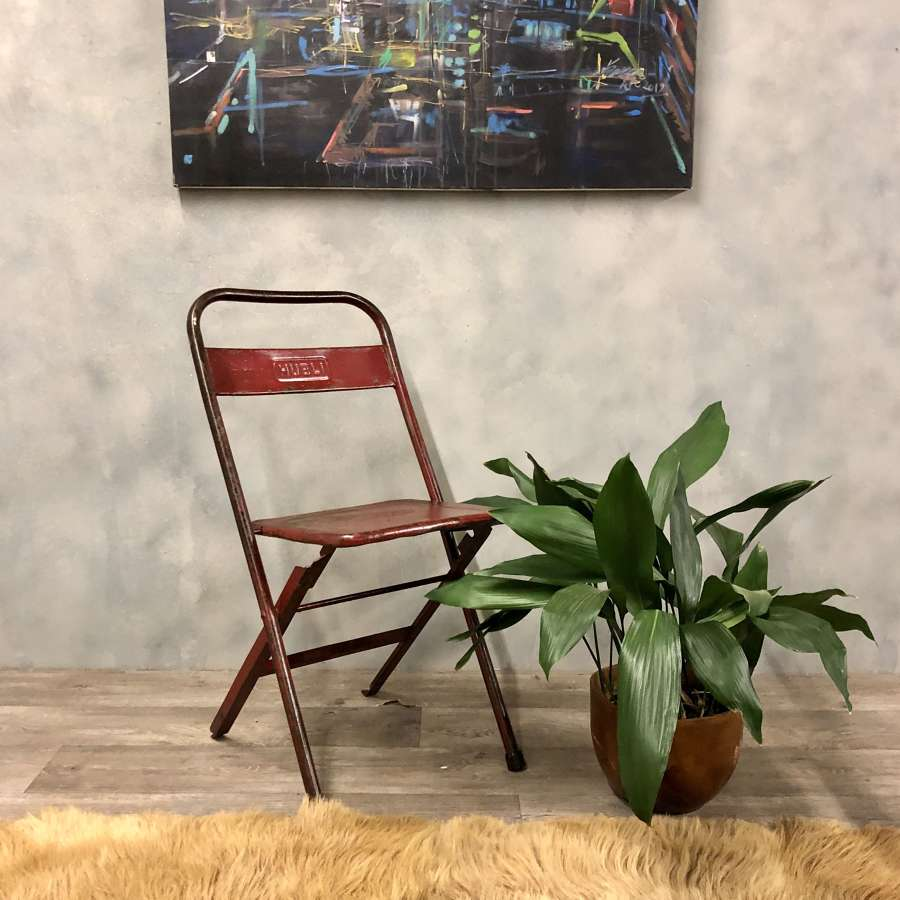 Vintage style metal fold up chair in red