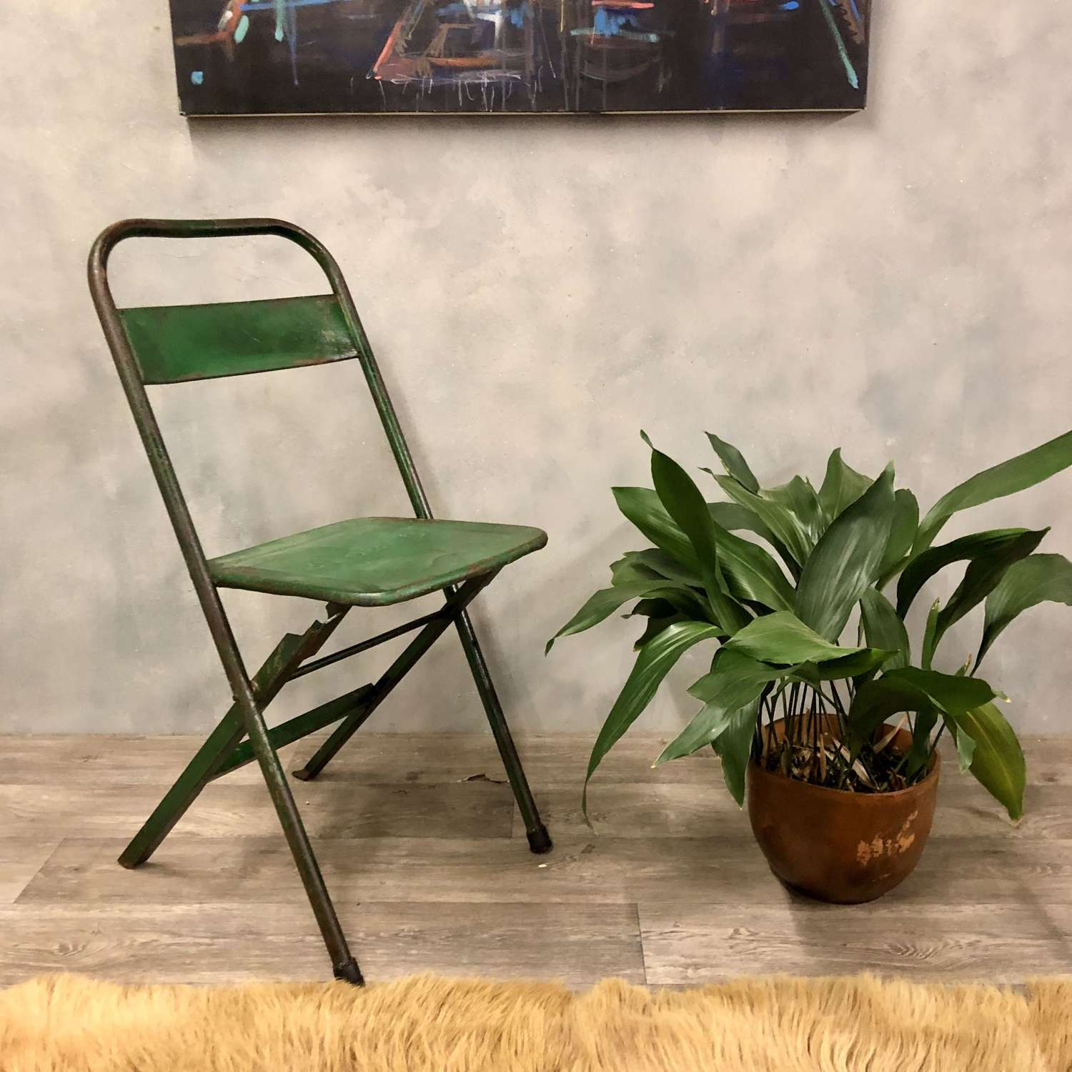 Vintage style metal fold up chair in green