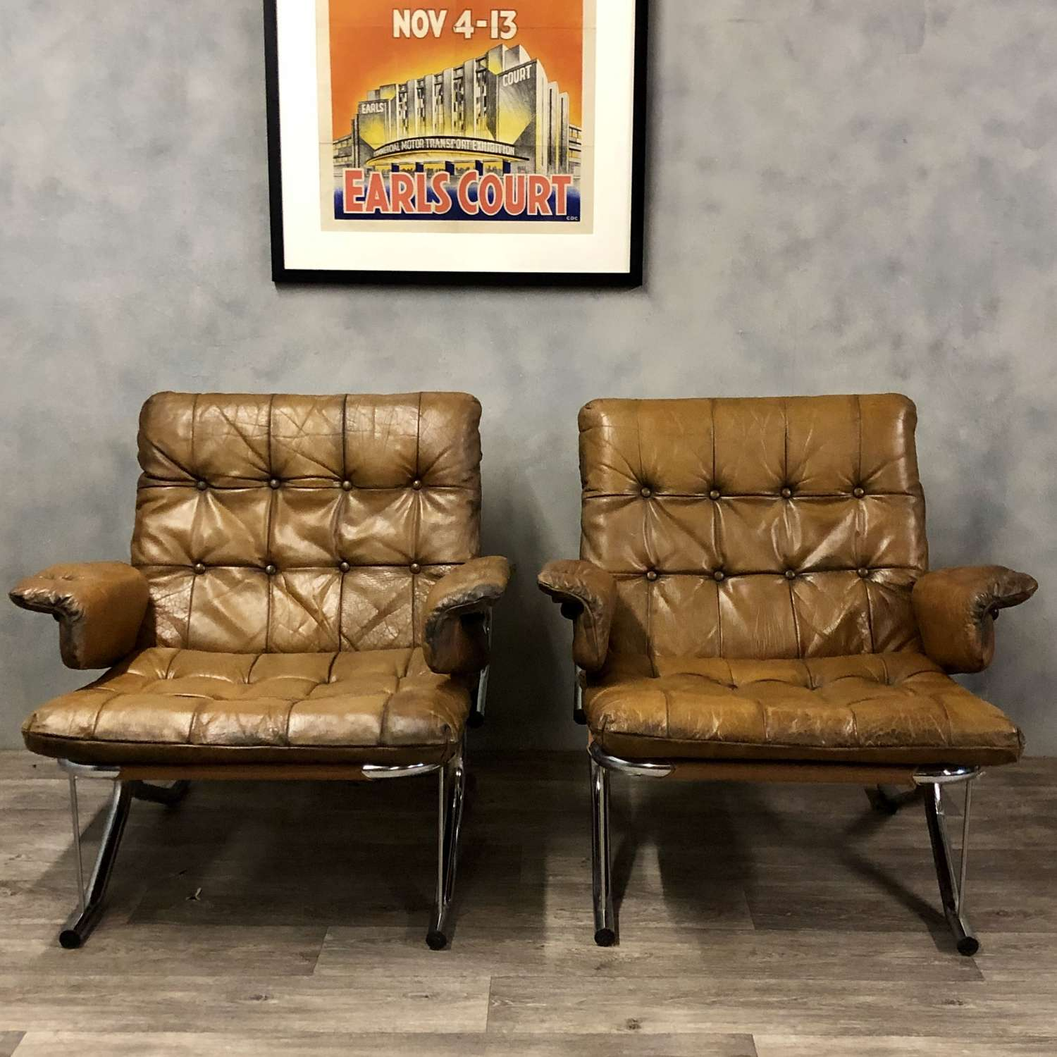 Midcentury lounge chairs in tan leather