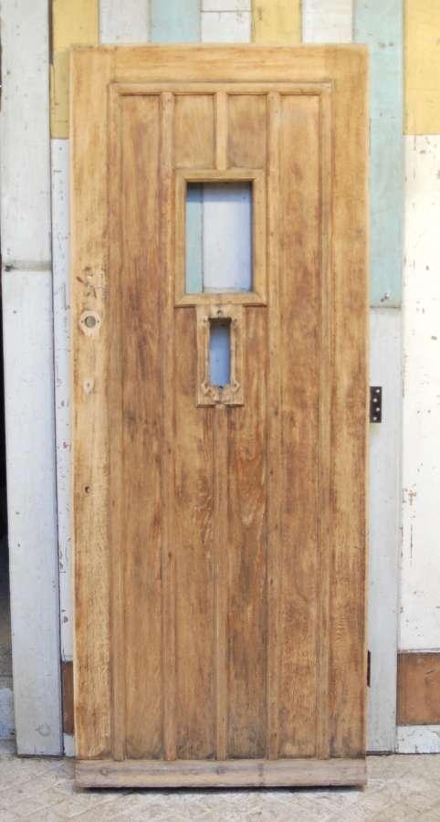 DE0825 A RECLAIMED BARE OAK FRONT DOOR WITH PANEL FOR GLAZING