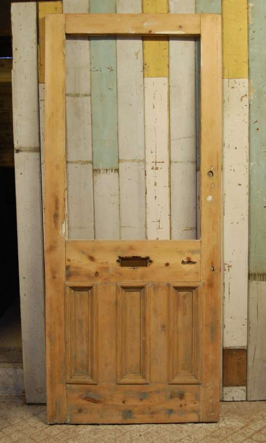 DE0826 A RECLAIMED STRIPPED PINE FRONT DOOR WITH PANEL FOR GLAZING