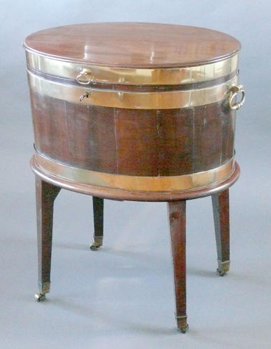 2045 A Georgian oval mahognay wine cooler