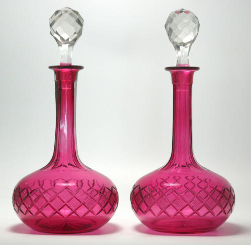 6583 A pair of cranberry/red shaft-and-globe decanters