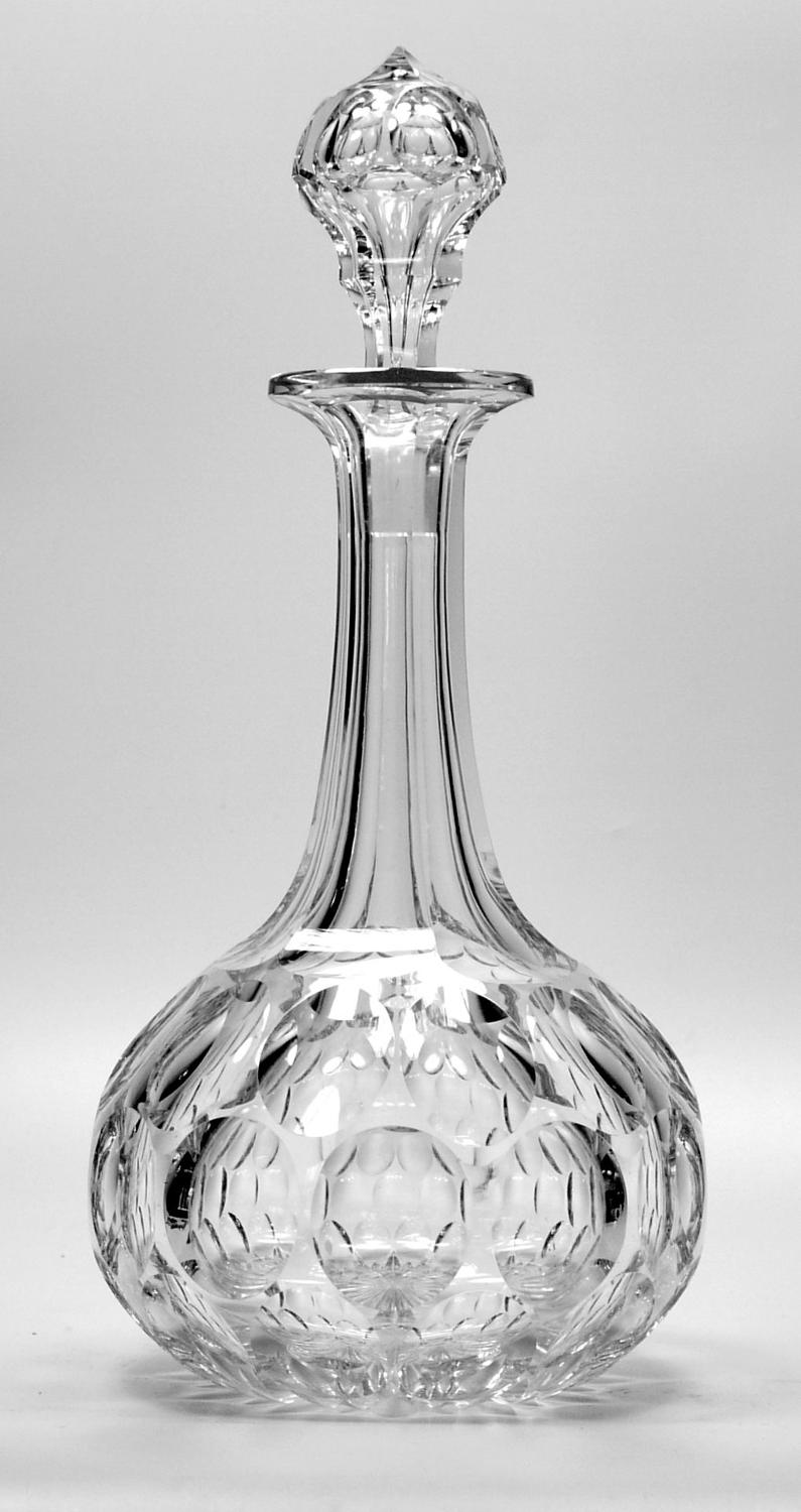6581 A fine MAGNUM shaft-and-globe decanter with cut decoration