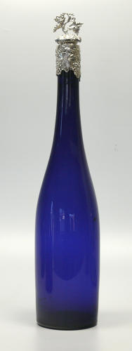 5266 A tall blue decanter with a silver mount and stopper