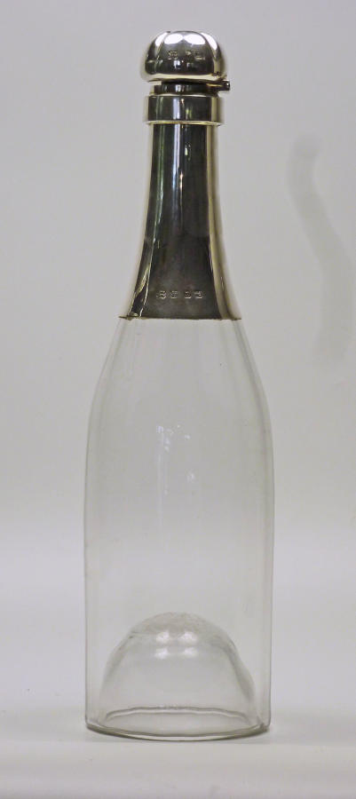 6534 A silver-mounted champagne decanter by Heath & Middleton