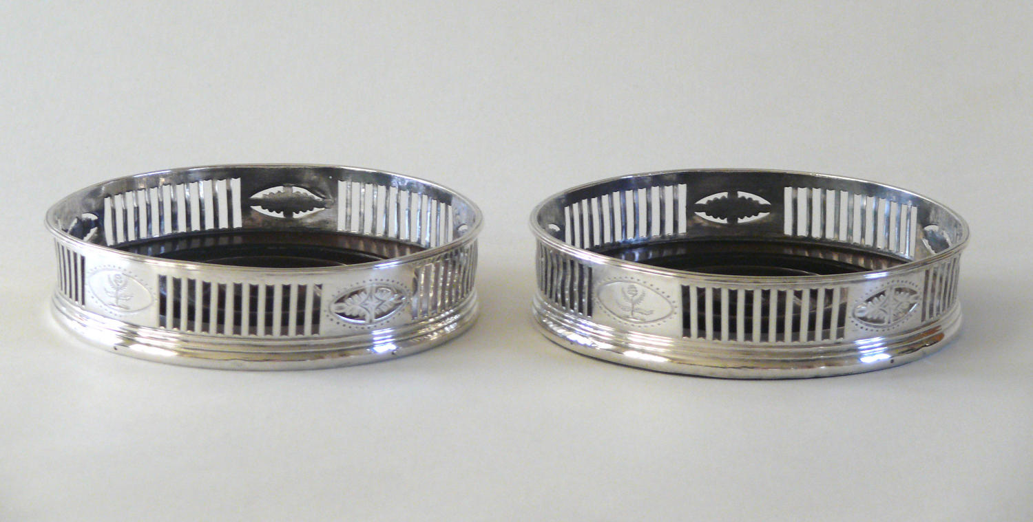 9765 A pair of silver neo-classical coasters 1785