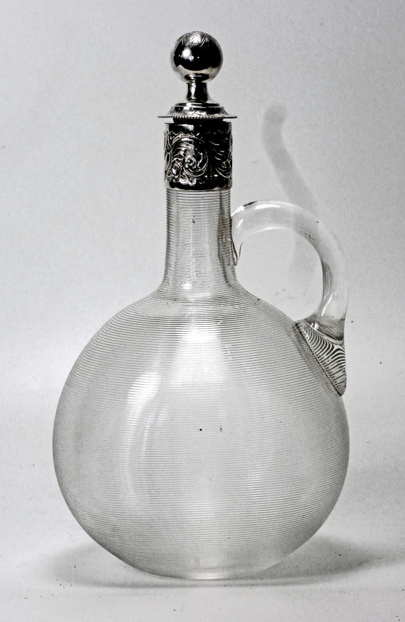 6532 A silver-mounted Victorian claret jug