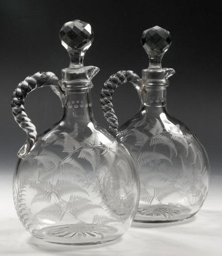 5172 A rare pair of Japanesque engraved claret flasks