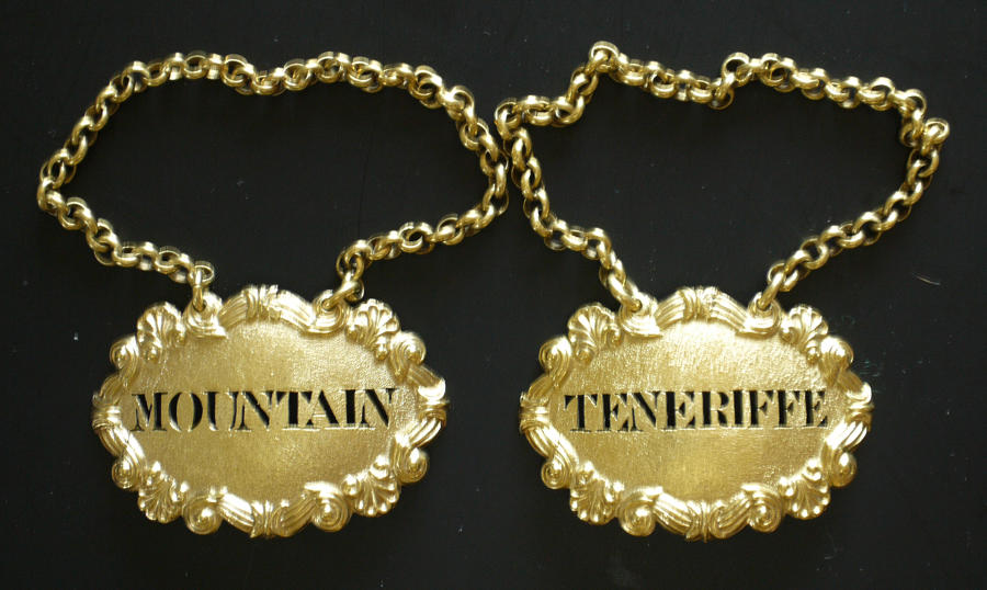 5108 A very fine pair of silver-gilt wine labels