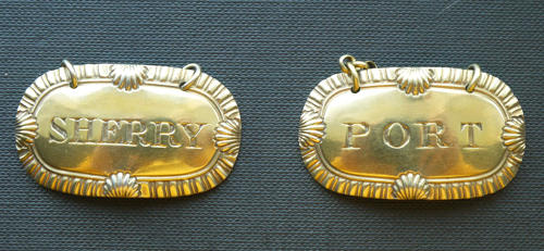 5211 A pair of silver-gilt wine labels by Charles Rawlings