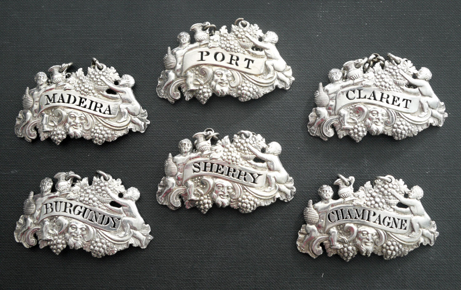 5223 A fine set of six silver wine labels by Phipps & Robinson