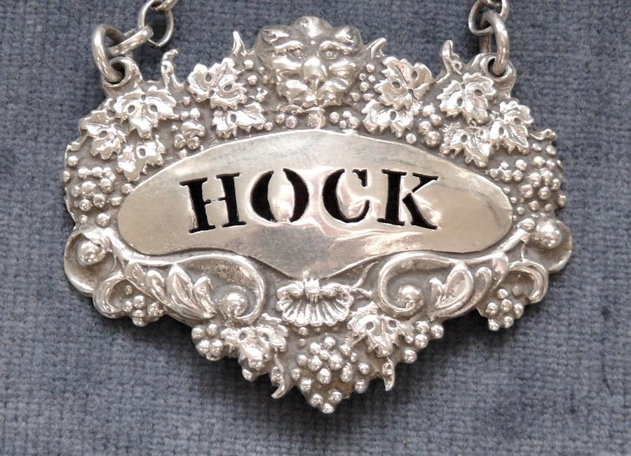 9876 A small cast silver wine label for Hock