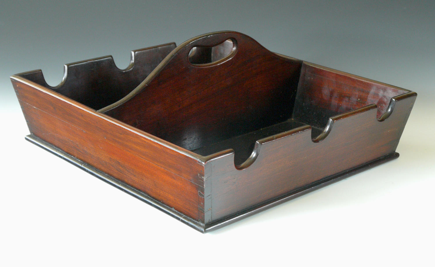 5032 An unusual mahogany bottle carrier