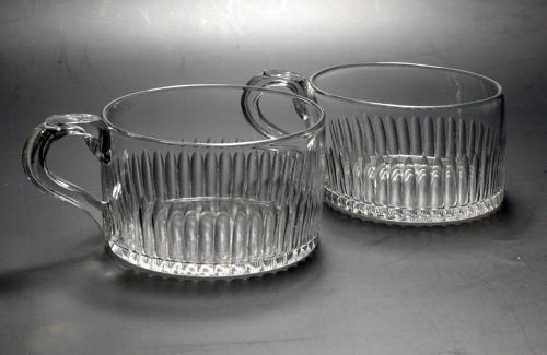 5119 A rare and delightful pair of Georgian glass mugs