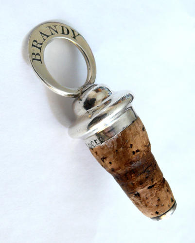 9654 A silver mounted cork engraved 'Brandy'