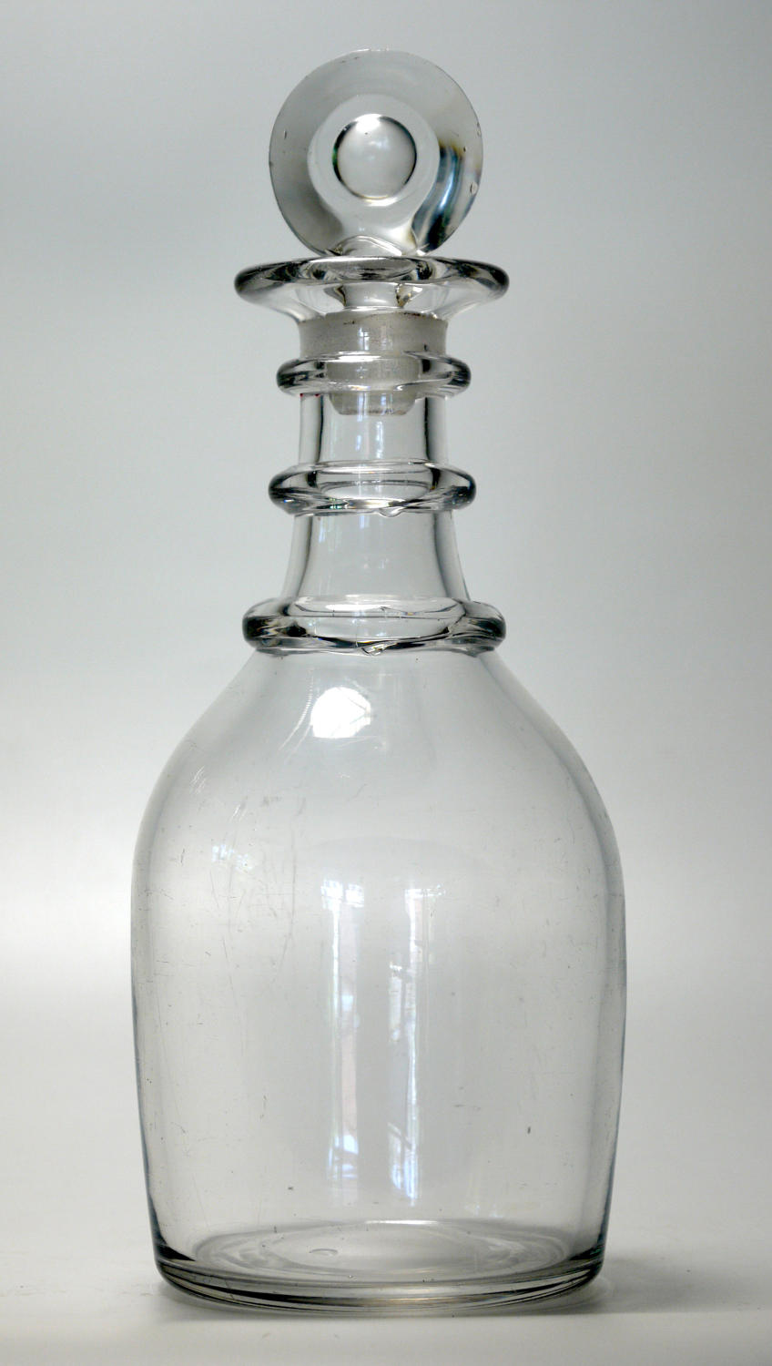 6585 A plain Georgian 'prussian' decanter with a target stopper