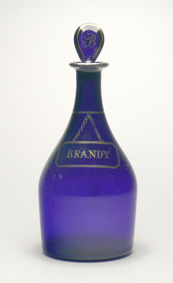 9552 A 'Bristol blue' decanter with a gilded label for Brandy
