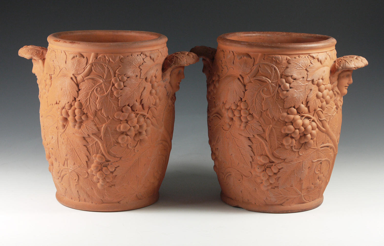 A pair of Wedgwood terra cotta wine coolers