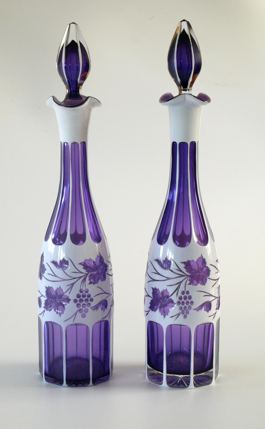 A pair of white and purple overlay tall decanters