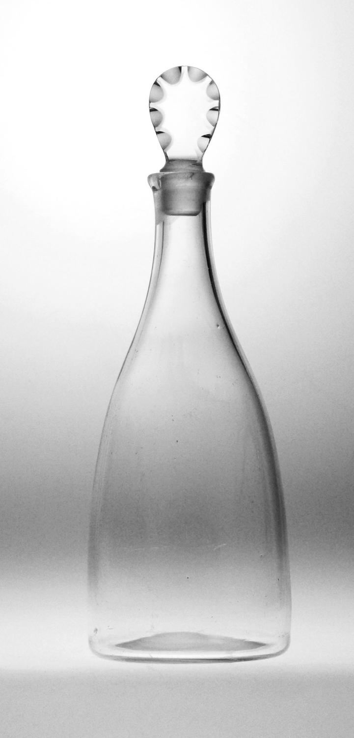 A plain taper decanter with a scalloped stopper