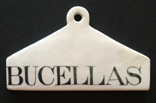 A pottery bin label for