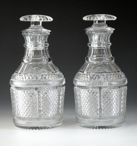 A fine and rare pair of decanters with tasting stoppers