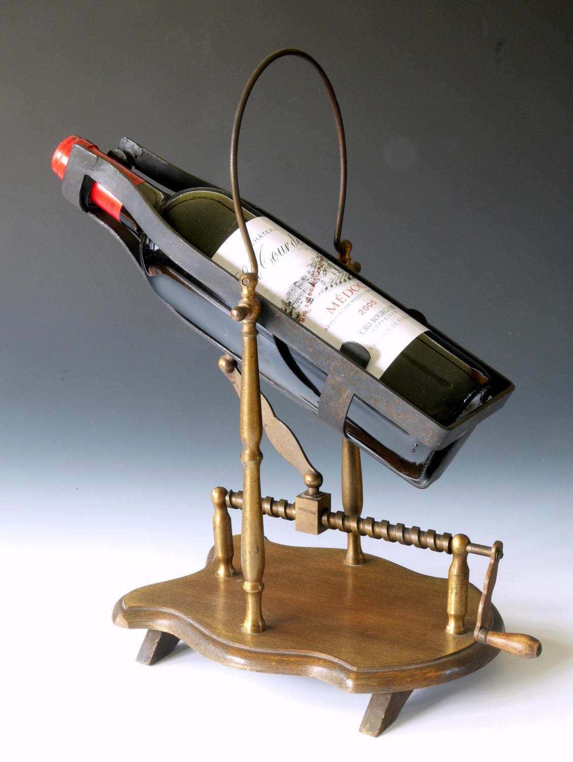 A walnut based decanting cradle