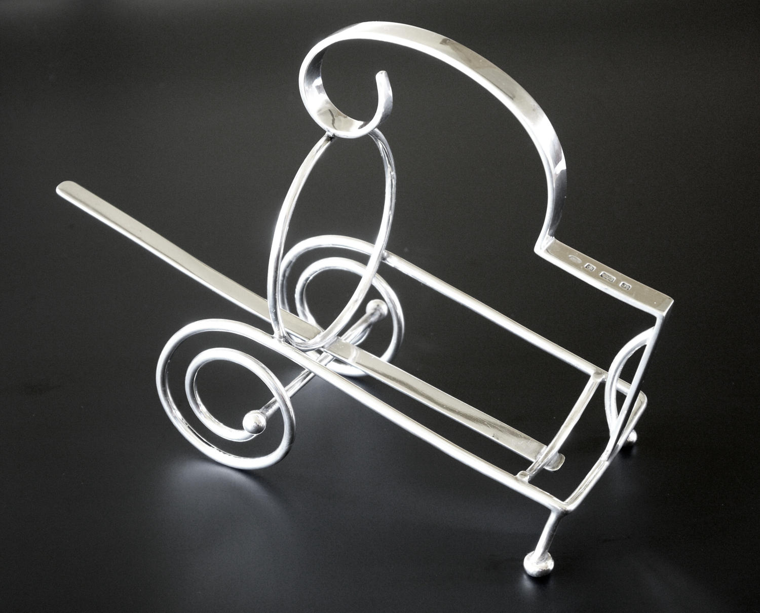 A quirky silver bottle cradle