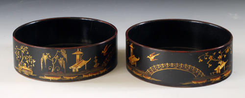 A very fine pair of chinoiserie lacquer coasters