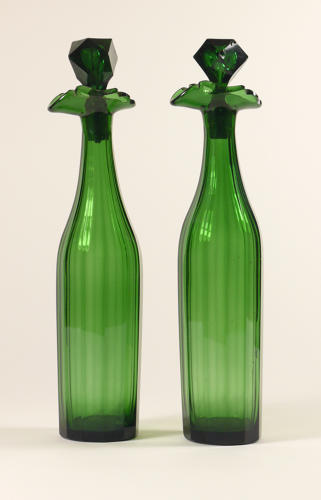 An attractive pair of tall green decanters