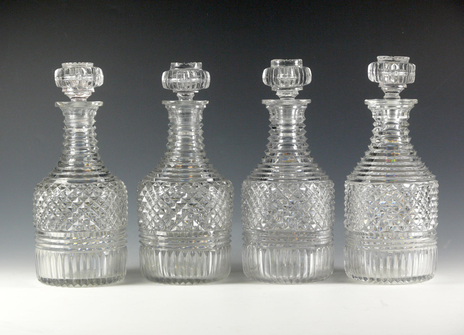 An exceptional set of 4 decanters with a pair of double trolleys