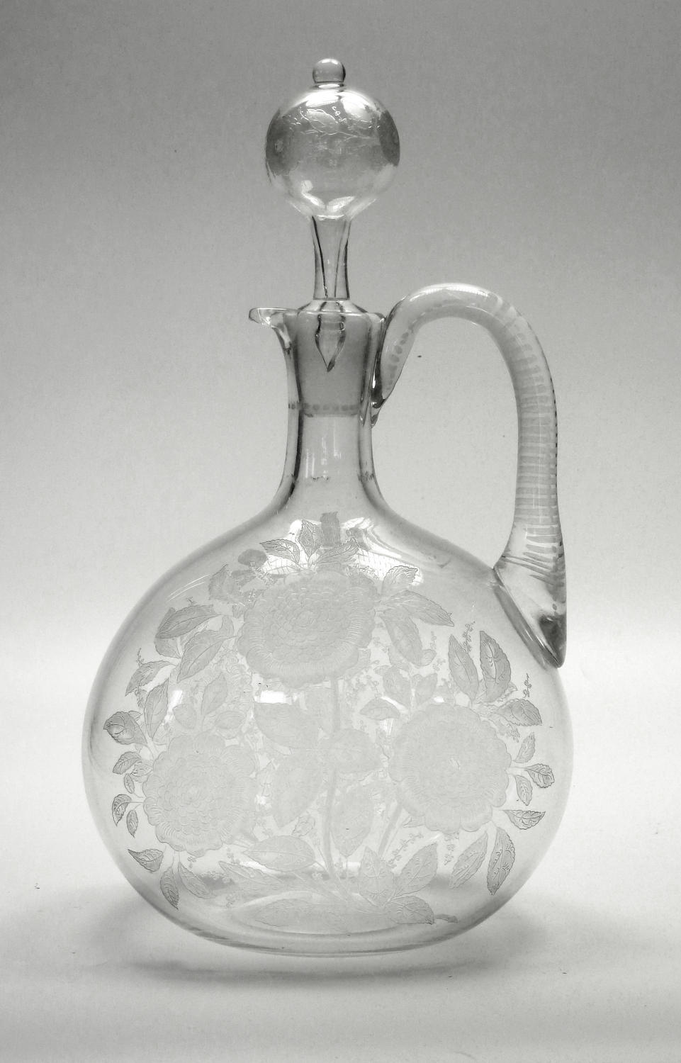 A fine etched, engraved and matted claret jug
