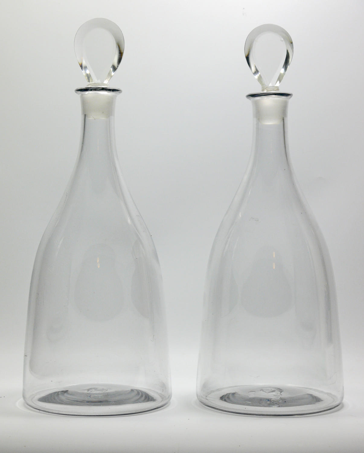 An exceptional pair of Georgian three-bottle decanters
