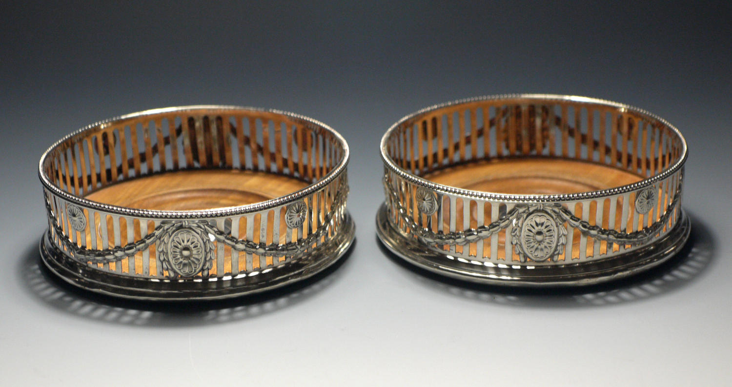 A pair of silver coasters by Robert Hennell of 1776