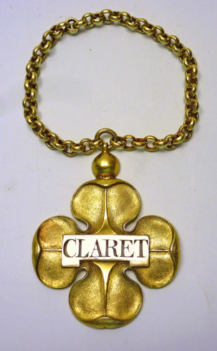 A fine silver-gilt 4-feaf clover wine label for CLARET