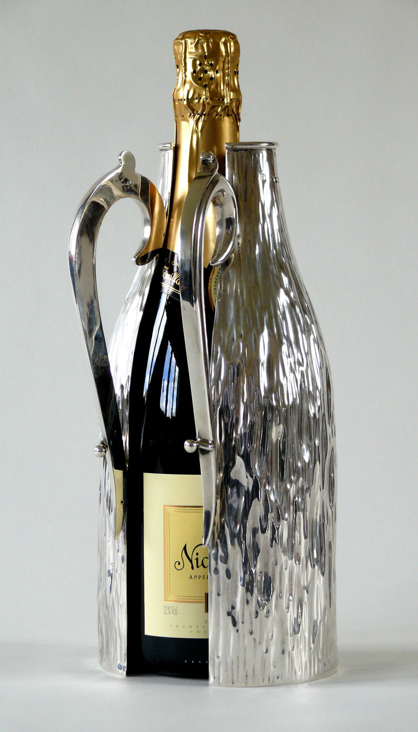 A rare silver champagne bottle holder