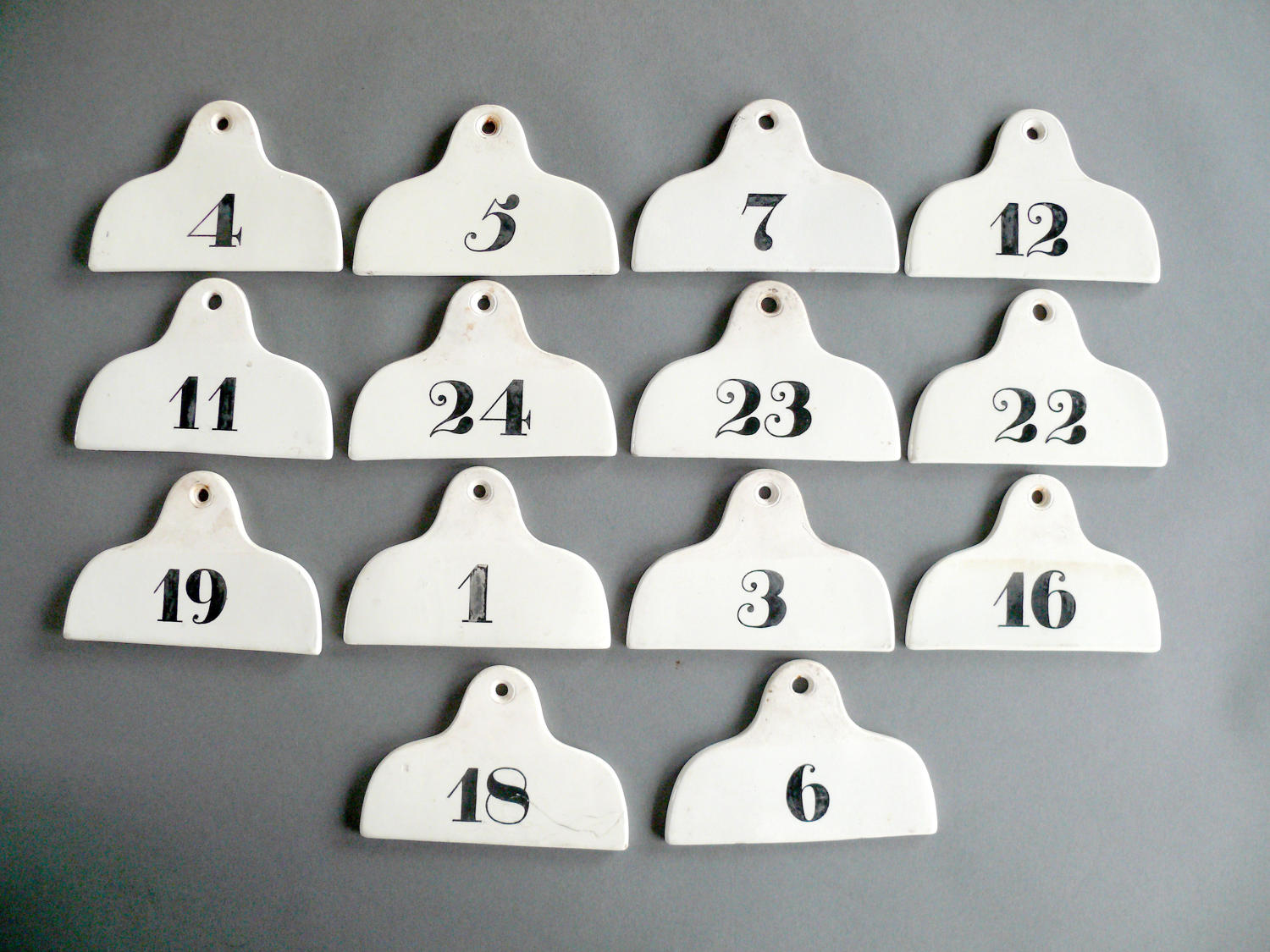 A rare set of 14 'coathanger' bin numbers
