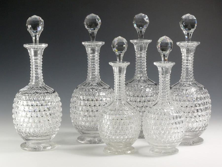 3049 A superb set of 6 shaft-and-globe decanters in sizes