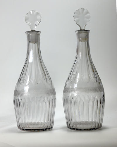 6574 A pair of cut 'Indian club' decanters