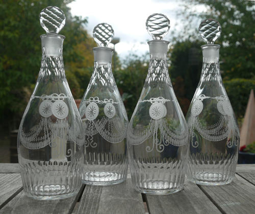 6601 A superb set of 4 engraved neo-classical club-shape decanters